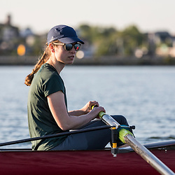 A woman from the Portland Community Rowing Association rows in Back Cove in Portland, Maine.