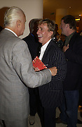 Manolo Blahnik and  Jasper Conran. Christopher Bailey hosts a party to celebrate the launch of ' The Snippy World of New Yorker Fashion Artist Michael Roberts' Burberry, New Bond St.  London. 19  September 2005. ONE TIME USE ONLY - DO NOT ARCHIVE © Copyright Photograph by Dafydd Jones 66 Stockwell Park Rd. London SW9 0DA Tel 020 7733 0108 www.dafjones.com