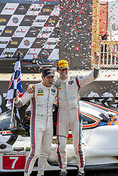 May 6, 2018 - Lexington, Ohio, United States of America - Ricky Taylor (USA) and Helio Cstroneves (BRA) celebrate their victory after winning the Acura Sports Car Challenge at Mid Ohio Sports Car Course in Lexington, Ohio. (Credit Image: © Walter G Arce Sr Asp Inc/ASP via ZUMA Wire)
