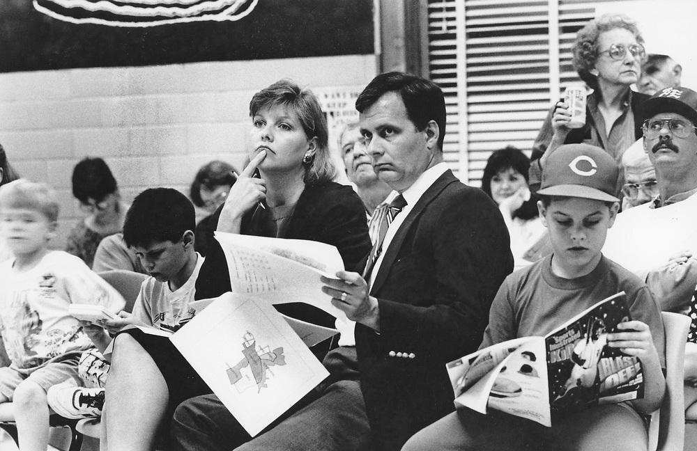 ©1991 public hearing on school closings as family listens to school board debates.  no MR EV-0227