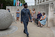 On the 100th anniversary of the Royal Air Force RAF and following a flypast of 100 aircraft formations representing Britains air defence history which flew over central London, a servieman leaves Horseguards, passing the memorial to those killed in the 2002 Bali bombing, on 10th July 2018, in London, England.
