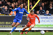 Wycombe Wanderers Midfielder Dominic Gape (4) and AFC Wimbledon Defender Toby Sibbick (20) in action during the EFL Sky Bet League 1 match between AFC Wimbledon and Wycombe Wanderers at the Cherry Red Records Stadium, Kingston, England on 27 April 2019.