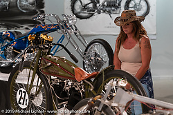 Checking out Mike Lange's 8-Valve 1927 Harley-Davidson Factory 1/2 Mile 8-valve racer in the The What's the Skinny Exhibition (2019 iteration of the Motorcycles as Art annual series) was popular with guests at the Sturgis Buffalo Chip, especially in the evenings before the big concerts during the Sturgis Black Hills Motorcycle Rally. SD, USA. Thursday, August 8, 2019. Photography ©2019 Michael Lichter.