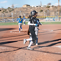 Navajo Pine Warriors senior Kamora Goodluck (4) crosses home plate to score against the Zuni Thunderbirds at Ford Canyon Park in Gallup Friday.