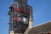 Big Ben and the Houses of Parliament covered in scaffolding under a massive refurbishment plan to save the building which is in a dreadful state of disrepair in London, England, United Kingdom.