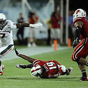 Miami Hurricanes running back Gus Edwards (7) outruns Louisville Cardinals cornerback Terell Floyd (19) during the NCAA Football Russell Athletic Bowl football game between the Louisville Cardinals and the Miami Hurricanes, at the Florida Citrus Bowl on Saturday, December 28, 2013 in Orlando, Florida. Louisville won the game by a score of 36-9. (AP Photo/Alex Menendez)