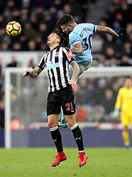 Newcastle United's Joselu (left) and Manchester City's Nicolas Otamendi (right) battle for the ball during the Premier League match at St James' Park, Newcastle.