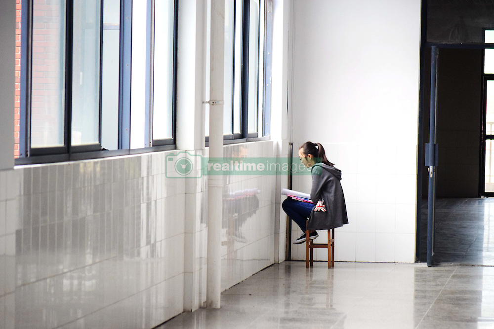 October 7, 2016 - Qingdao, Qingdao, China - Qingdao, CHINA-October 7 2016: (EDITORIAL USE ONLY. CHINA OUT) A student reviews schoolwork at library in Qingdao University of Science and Technology in Qingdao, east China¡¯s Shandong Province, October 7th, 2016. Many college students chose to stay at school to prepare for postgraduate entrance examination instead of traveling or resting during the National Day holiday, known as ''Golden Week' (Credit Image: © SIPA Asia via ZUMA Wire)