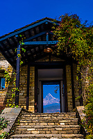 View of the Fishtail (Machapuchare) peak of the Annapurna Massif of the HIimalyas through the front door of  Tiger Mountain Pokhara Lodge, Lekhnath (near Pokhara), Nepal.
