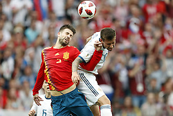 (l-r) Gerard Pique of Spain, Fyodor Smolov of Russia during the 2018 FIFA World Cup Russia round of 16 match between Spain and Russia at the Luzhniki Stadium on July 01, 2018 in Moscow, Russia