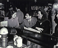 1945 Sidney Skolsky chats with movie fans at Schwabs Drugstore