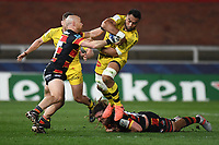 Rugby Union - 2020 / 2021 European Rugby Heineken Champions Cup - Round of 16 - Gloucester vs La Rochelle - Kingsholm<br /> <br /> La Rochelle's Victor Vito is tackled by Gloucester's Willi Heinz and Jordy Reid.<br /> <br /> COLORSPORT/ASHLEY WESTERN
