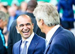 Everton Manager, Roberto Martinez  shares a joke with Manchester City Manager, Manuel Pellegrini - Mandatory byline: Matt McNulty/JMP - 07966386802 - 23/08/2015 - FOOTBALL - Goodison Park -Everton,England - Everton v Manchester City - Barclays Premier League