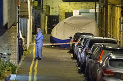 © Licensed to London News Pictures. 05/12/2019. London , UK. A police tent sits on Clarence Mews as forensic investigators gather evidence at the scene of a fatal stabbing in Hackney. Police were called at 14:01 GMT and attended alongside London Ambulance Service and London's Air Ambulance where they found a man seriously injured. Despite their best efforts the man - believed to be aged in his 20s - was pronounced dead at the scene at 14:33hrs. Photo credit: Peter Manning/LNP