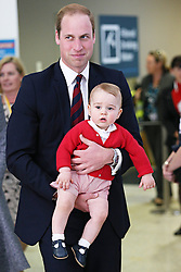 The Duke and Duchess of Cambridge, William and Catherine, with their son Prince George.<br /> The Royal family boarded their RAAF plane at Canberra airport on the final day of their tour of Australia and New Zealand then made a transfer on to an international flight in Sydney,  Friday, 25th April 2014. Picture by Media-Mode / i-Images<br /> UK ONLY
