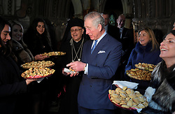 December 23, 2017 - London, London, United Kingdom - Image licensed to i-Images Picture Agency. 19/12/2017. London, United Kingdom.  The Prince of Wales is offered sweet biscuits after meeting families who have escaped persecution in the Middle East after a service of prayers by the Melkite Greek-Catholic community at St. Barnabas Church in London. (Credit Image: © Rota/i-Images via ZUMA Press)