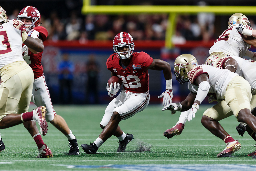 Alabama Crimson Tide running back Najee Harris (22) carries the ball against the Florida State Seminoles during the Chick-fil-A Kickoff NCAA football game on Saturday, September 2, 2017, in Atlanta. (Paul Abell via Abell Images for Chick-fil-A Kickoff Game)