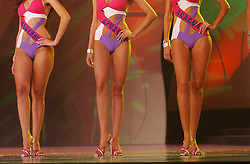 Women participate in the Miss Venezuela Beauty pagaent.  Contestants, hand picked by the Miss Venezuela Organization, spends months leading up to the contest in pageant training classes.  This years winner, Miss Guárico Mónica Spear, will represent Venezuela in the Miss Universe contest.