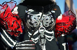 09 February 2016. New Orleans, Louisiana.<br /> Mardi Gras Day. Walking with Skeletons. Skeleton breasts. The Skeleton Krewe meet before sunrise and walk 5 miles from Uptown, making their way along St Charles Avenue and into the French Quarter where they celebrate Mardi Gras Day.<br /> Photo©; Charlie Varley/varleypix.com