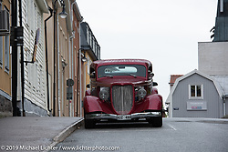 A hotrod parked on the street in downtown Norrtälje after the annual Motorcycle Show in the park organized by the Twin Club of Norrtälje, Sweden. Saturday, June 1, 2019. Photography ©2019 Michael Lichter.
