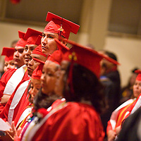 121712       Brian Leddy<br /> Navajo Technical College students listen to a commencement address during graduation ceremonies at Red Rock Park Monday morning. The school saw 79 students graduate this winter.