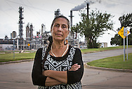 Casey Camp-Horinek in Ponca City, Oklahoma across from a Conco Philips refinery.  Casey is a Native American, an elder in the Ponca tribe who has been fighting against industry for years. Landmen are leasing land where the Ponca live now for fracking. The area is plagued by earthquakes.