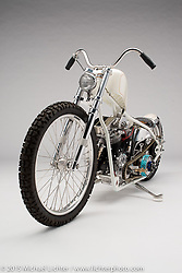 """""""Egret"""", a white diamond pearl custom built from a 1952 Harley panhead by Bill Dodge of Bling's Cycles in Daytona Beach, FL as a tribute to friend John Green. Photographed by Michael Lichter at the Nashville Easyriders Show on February 6, 2015. ©2015 Michael Lichter."""