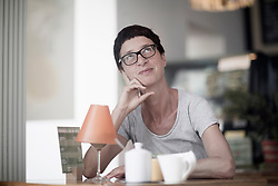 Thoughtful mature woman drinking coffee in coffee shop, Freiburg im Breisgau, Baden-W¸rttemberg, Germany