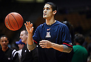 SHOT 1/21/12 4:42:30 PM - Arizona's Nick Johnson #13 warms up before playing against Colorado during their PAC 12 regular season men's basketball game at the Coors Events Center in Boulder, Co. Colorado won the game 64-63..(Photo by Marc Piscotty / © 2012)