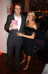 MR TOM PARKER BOWLES son of Camilla Parker Bowles and MISS SARA BUYS at a party to celebrate the publication of 'E is for Eating' by Tom Parker Bowles held at Kensington Place, 201 Kensington Church Street, London W8 on 3rd November 2004.<br />