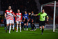 Peter Bankes (Referee) goes to speak to his assistant as Doncaster appeal for a penalty during the The FA Cup fourth round match between Doncaster Rovers and Oldham Athletic at the Keepmoat Stadium, Doncaster, England on 26 January 2019.
