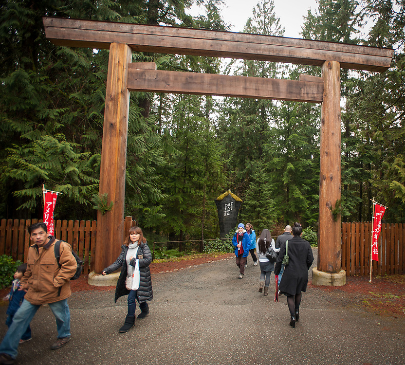 2014 January 01 - People walk through the torii gate at Tsubaki Grand Shrine, Granite Falls, WA. New Years Hatsumode. By Richard Walker