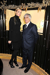 BERNIE ECCLESTONE and his daughter PETRA ECCLESTONE at a party to celebrate the launch of a collection of jewellery by Tamara Ecclestoen for jewellers Moussaieff held at their store in New Bond Street, London on 9th December 2008.