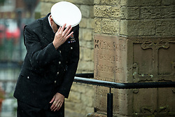 © Licensed to London News Pictures . 15/07/2016 . Bolton , UK . A police officer pauses to bow his head before entering the church for the service .  The funeral of Special Constable Samantha Derbyshire at St Mary's RC Church in Horwich , Bolton. Derbyshire was struck and killed by an HGV on the M61 motorway following a collision , in the early hours of Monday 11th July 2016 . Photo credit : Joel Goodman/LNP