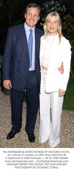 The MARQUESS & MARCHIONESS OF MILFORD HAVEN, at a dinner in London on 20th May 2002.PAF 28