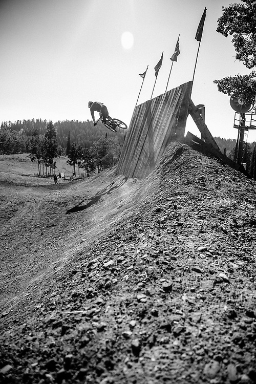 Andrew Whiteford gets air off one of the features in bike skills area of Grand Targhee Resort, Wyoming.