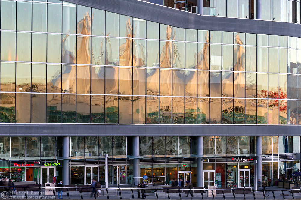 The reflection of the sails of Canada Place in the glass at the Vancouver Convention Center. Photographed in Vancouver, British Columbia, Canada.