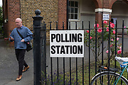 A voter leaves the polling station on the morning of the UK 2017 general elections outside the polling station at St. Saviours Parish Hall in Herne Hill, Lambeth, on 8th June 2017, in London, England.
