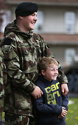 Private Daniel Bradley with his brother Jay Dolan, 8, at Custume Barracks, Athlone, following a review of the 110th Infantry Battalion ahead of their six-month deployment to South Lebanon as part of United Nations Interim Force in Lebanon (Unifil).
