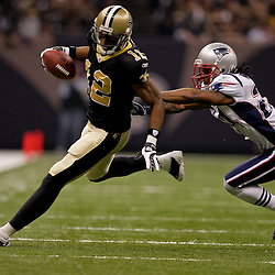 2009 November 30:  New Orleans Saints wide receiver Marques Colston (12) runs away from New England Patriots cornerback Jonathan Wilhite (24) during a 38-17 win by the New Orleans Saints over the New England Patriots at the Louisiana Superdome in New Orleans, Louisiana.