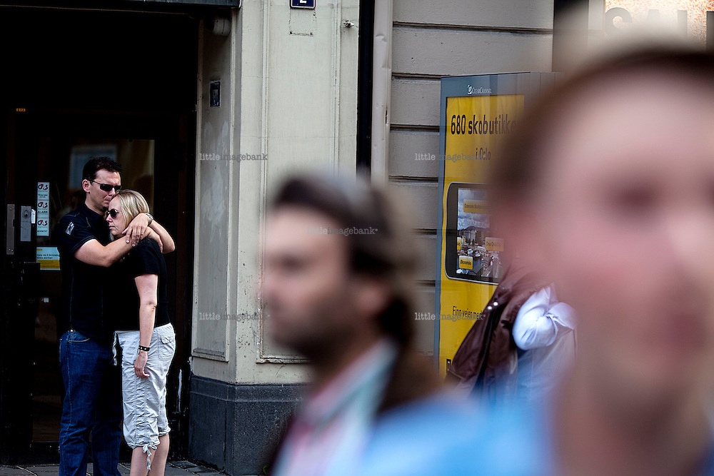 Oslo, Norway, 23.07.2011. People watching the devastation a from distance. Oslo awakes to shocking messages of the total bodycount after yesterdays massacre. A total of 91 persons were killed in the massacre in Utøya right outside Oslo. Seven of those died when a car bomb was detonated outside the main government biuilding in the heart of Oslo, friday 22. of July. Foto: Christopher Olssøn.