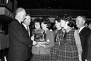 25/04/1964<br /> 04/25/1964<br /> 25 April 1964<br /> Gael Linn Secondary Schools Debating Competition final at the Shelbourne Hotel, Dublin. Proinsias Mac A'Beatha, Stuirthoir, Inniu, presenting the Sciath Inniu trophy to the captain, Mairin Ni Chonchubhair, and members of the Colaiste Ide, Daingean (Dingle), Co. Kerry team, Mairead Ni Ghabann; Eilin Nic Gearailt and Maire Nic Suibhne, who won the team award. Also in the image is Mr Charles Haughey, Minister for Justice.