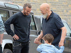 David Beckham, Michael Eavis and his grandson Noah celebrate a completed housing development in Pilton village in Somerset.
