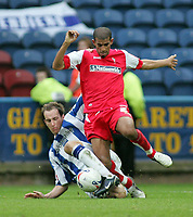 Photo: Paul Thomas.<br /> Huddersfield Town v Swindon Town. Coca Cola League 1. 29/10/2005. <br /> <br /> Swindon's Hameur Bouazza gets tackled by David Mirfin.
