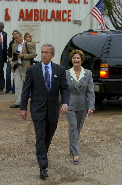 Crawford, Texas 02 NOVEMBER 2004: U.S. President George W. Bush and wife Laura outside the Crawford Fire Hall where they voted Tuesday in the presidential election.  ©Bob Daemmrich /
