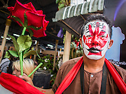 28 APRIL 2014 - BANGKOK, THAILAND: A Red Shirt activist at the funeral for Kamol Duangphasuk, 45, in Bangkok. Kamol was a popular poet who wrote under the pen name Mai Nueng Kor Kunthee. Kamol had been writing since the 1980s and was an outspoken critic of the 2006 coup that deposed Thaksin Shinawatra. After the 2010 military crackdown against the Red Shirts he went into temporary self imposed exile fearing for his safety. After he returned to Thailand he organized weekly protests against Thailand's Lese Majeste laws, which he said were being used to stifle dissent. Kamol was shot and murdered on April 23. The assailants are still at large but the murder is thought to be political.     PHOTO BY JACK KURTZ