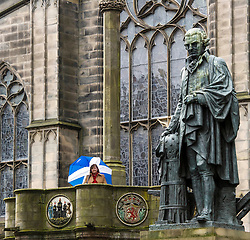 Pictured: Fiona Hyslop on top of the Mercat Cross next to the Adam Smith statue on the High Street<br /> Ahead of parliamentary debate on the Year of History, Heritage and Archaeology, Culture Secretary Fiona Hyslop visited Edinburgh's Mercat Cross on the High Street to learn how Scotland is capitalising on the booming demand from tourists to explore the nation's history and genealogy. <br /> Ger Harley | EEm 31 January 2017