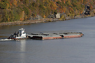 Fort Montgomery, NY - A tugboat pushes barges down the Hudson River just south of the Bear Mountain Bridge  on Nov. 2, 2008.