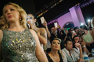 Spectators and jury members (seated bottom right) watch the participants in Istanbul's second Trans beauty pageant, held at The Mekan. The women had both swimwear and evening gown shows for the judges.