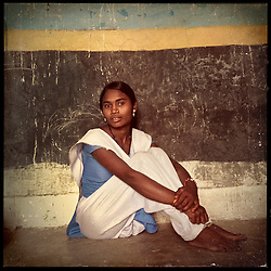 """iPhone portrait of Lakshmi in a village outside of Banswara, Rajasthan, India, April 5, 2013. """"My sister lives nearby and she told me that my parents we getting me married. I said no, I don't want to get married. The life gets ruined when you marry at a young age,"""" said Lakshmi.<br /> <br /> Under Indian law, children younger than 18 cannot marry. Yet in a number of India's states, at least half of all girls are married before they turn 18, according to statistics gathered in 2012 by the United Nations Population Fund (UNFPA). However, young girls in the Indian state of Rajasthan—and even a few boys—are getting some help in combatting child marriage. In villages throughout Tonk, Jaipur and Banswara districts, the Center for Unfolding Learning Potential, or CULP, uses its Pehchan Project to reach out to girls, generally between the ages of 9 and 14, who either left school early or never went at all. The education and confidence-building CULP offers have empowered young people to refuse forced marriages in favor of continuing their studies, and the nongovernmental organization has provided them with resources and advocates in their fight."""